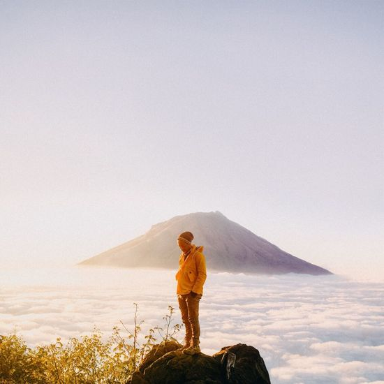 Sindoro Mountain One Person Sky Mountain Leisure Activity Copy Space Standing Beauty In Nature Scenics - Nature Lifestyles Nature Real People Holiday Full Length Tranquility Young Adult Vacations Land Adult Trip Outdoors Sindoro Wonosobo INDONESIA Dieng Mountain Range