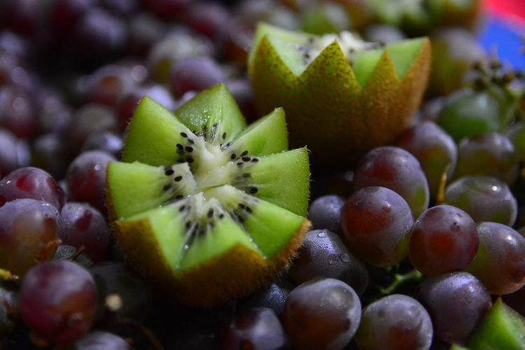 Full frame shot of kiwi and grapes
