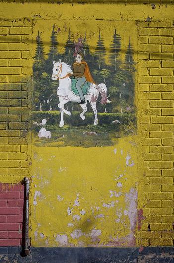 Graffiti on brick wall in city