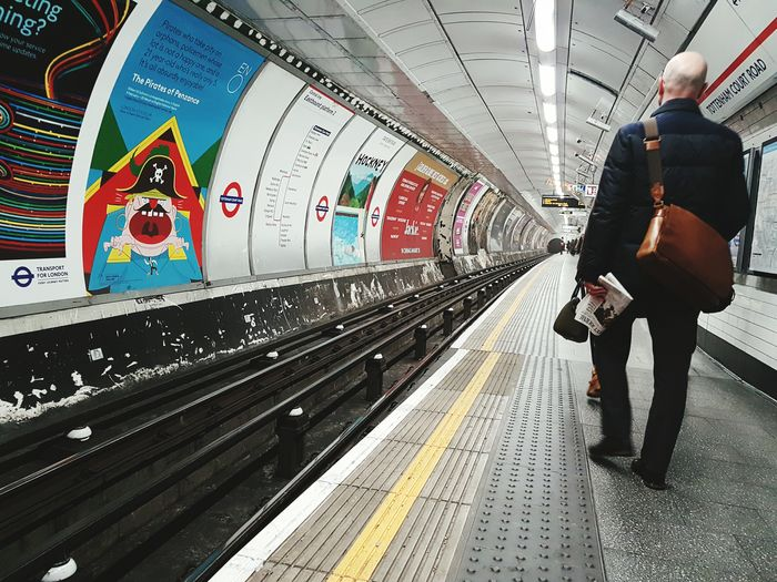 Friday morning One Person One Man Only Indoors  Architecture Urban Uk City Life Traffic Travel London Iconic Commuter Underground Tube Walking Symmetry Geometries Real People Tube Station  Low Angle View People City EyeEm LOST IN London