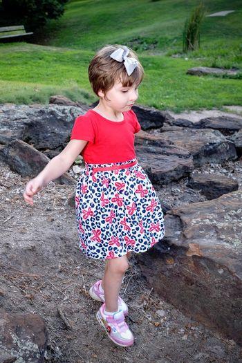 Full length of girl on rock at park
