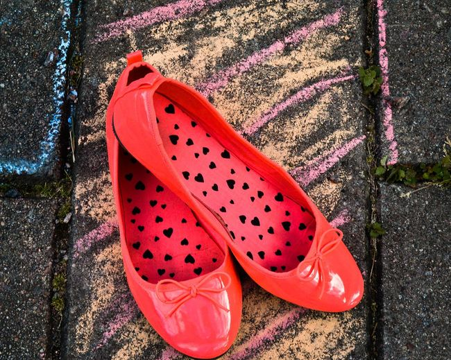 High angle view of red shoes on footpath