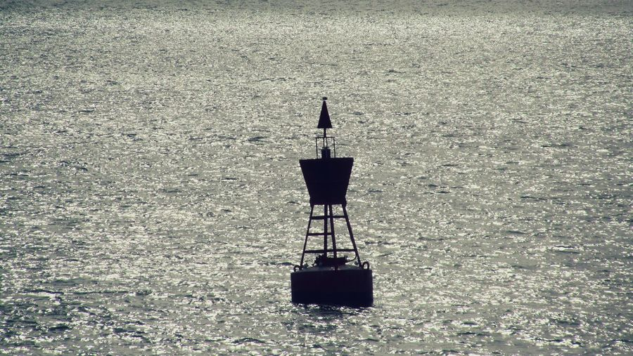 Moored Buoy On The Ocean Navigational Instrument Navigation Lights Shipping  Harbor Shipping  Freight Transportation Transportation Shippingworldwide Nautical Vessel Ships At Sea Mode Of Transport Industry Sea Business Finance And Industry Seaport Harbour Berthing