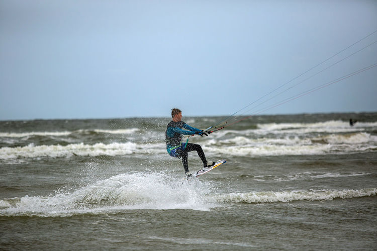 Baltic Baltic Sea Adventure Freedom Full Length Fun Holiday Horizon Over Water Kiteboarding Leisure Activity Males  Men Motion Nature One Person Outdoors Sea Sky Splashing Sport Surfing Water Wave