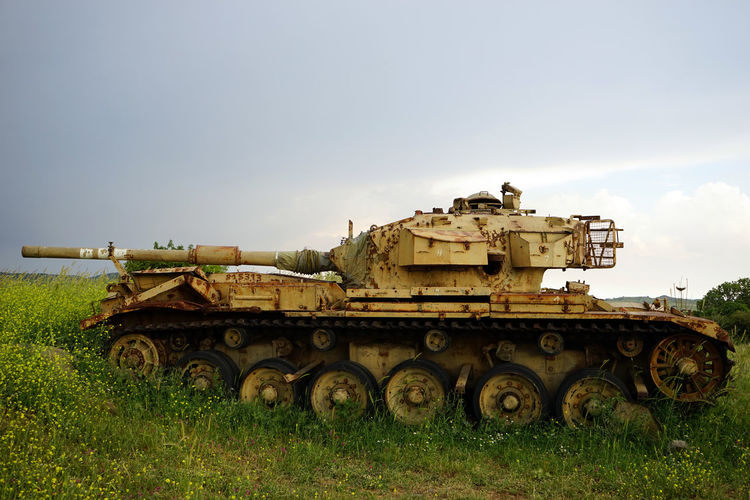 Field Grass Land Military Day Sky Tank Nature Weapon No People Armored Tank Copy Space Outdoors Armed Forces War Fighting Plant Conflict The Past Transportation