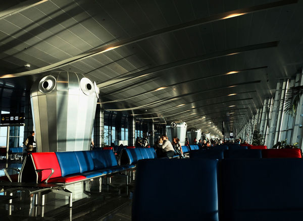Airconditioning Airport Day Departure Depth Of Field Farewell Futuristic Gates Illuminated Indoors  Low Angle View Metal Modern Architecture Public Transportation Real People Technology Waiting Hall