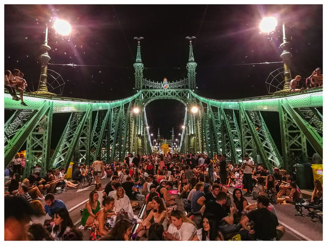 The young people are celebrating on the bridge. Travel Destinations Stritphoto Turistic Attractions Tredition Hungary Arts Culture And Entertainment Enjoyment Fun