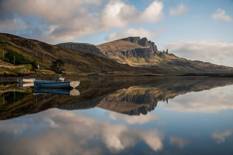 Scotland The Great Outdoors - 2018 EyeEm Awards The Old Man Of Storr Boat Boats Idyllic Lake Mountain Mountain Range Outdoors Reflection Reflection Lake Symmetry Water Waterfront