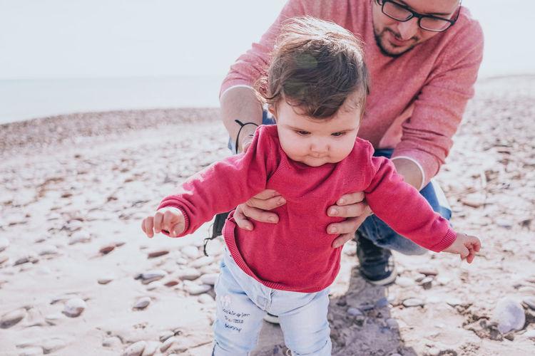 Baby girl on beach