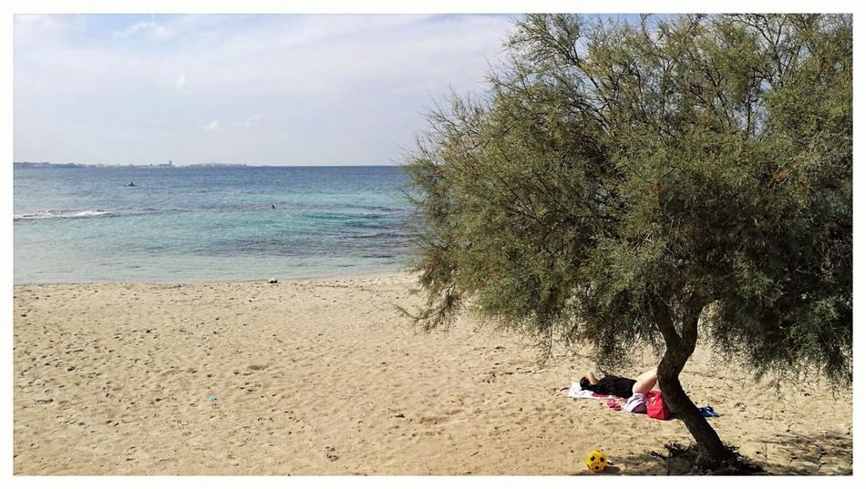 Santa Maria Al Bagno Puglia Italy Beach Sea Sand Horizon Over Water Nature Real People Water Day Outdoors Leisure Activity One Person Lifestyles Tree Full Length Vacations Scenics Beauty In Nature Sky Smartphone Photography Android Photography Bathers Sunbathers