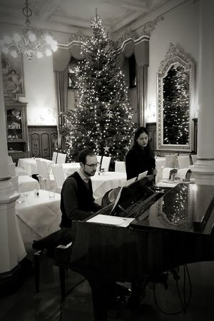 Two People Christmas Tree Adults Only Christmas Full Length Indoors  Christmas Decoration People Adult Well-dressed Piano Men Young Adult Christmas Ornament Concert Musicians Singer  Hotel Life Hotel Blackandwhite Black & White Black And White