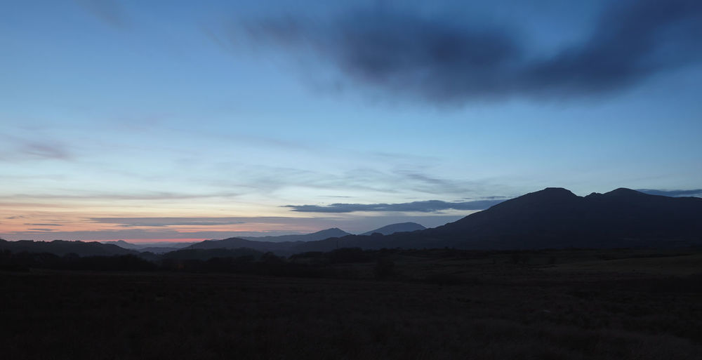Silhouettes of Snowdonia mountains in North Wales just after sunset. Beauty In Nature Cloud Cloud - Sky Cloudy Dramatic Sky Landscape Mountain Mountain Range No People Non-urban Scene Silhouette Sky Sunset Tranquility Wales