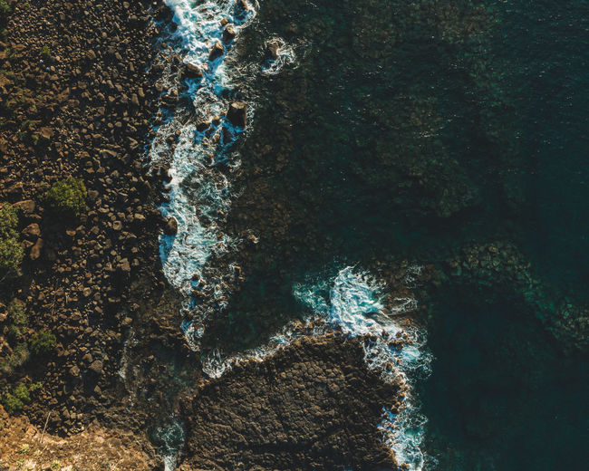 High angle view of water on rock in sea