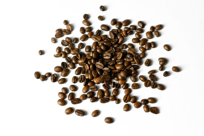 Pile of coffee beans on white background - coffee minimalism Caffeine Coffee Coffee Time Copy Space EyeEmNewHere EyeEmReady Food And Drink Backgound Brown Caffeine Addict Close-up Coffee Bean Coffee Beans Design Element Food Porn Group Of Objects Minimal Minimalism No People On White Roasted Coffee Bean Scattered Studio Shoot Studio Shot White Background