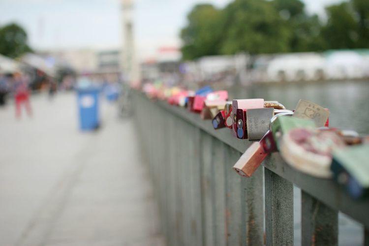 Close-up of padlocks on railing in city