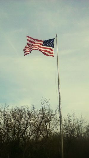 Are you truly free? EyeEmNewHere Stars And Stripes Flying Patriotism Pride Flag Cultures Striped Wind Independence Sky