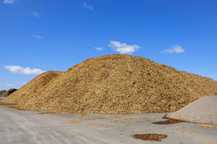 View of arid landscape against blue sky