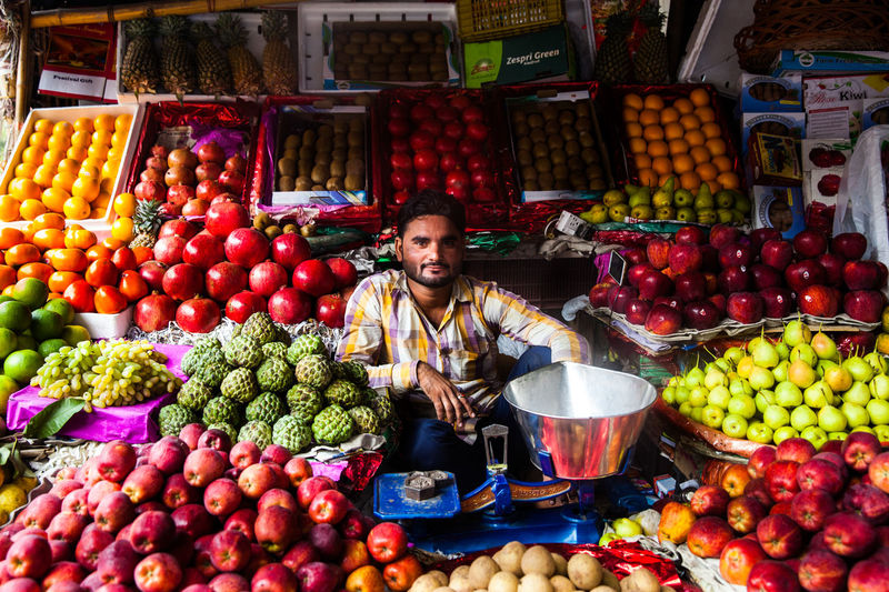 India Culture New Delhi Poverty Lives. For The Hope Of Light. Man Selling Fruits In India Poverty Poverty But Happiness