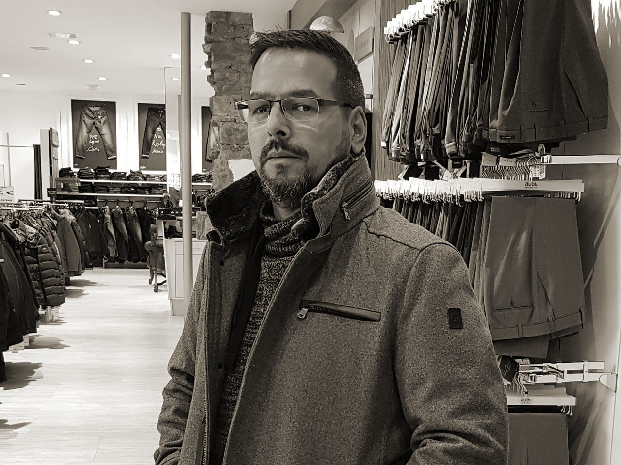 one person, clothing, portrait, mature adult, mature men, looking at camera, waist up, indoors, adult, fashion, shopping, business, men, males, glasses, retail, store, standing, consumerism, warm clothing