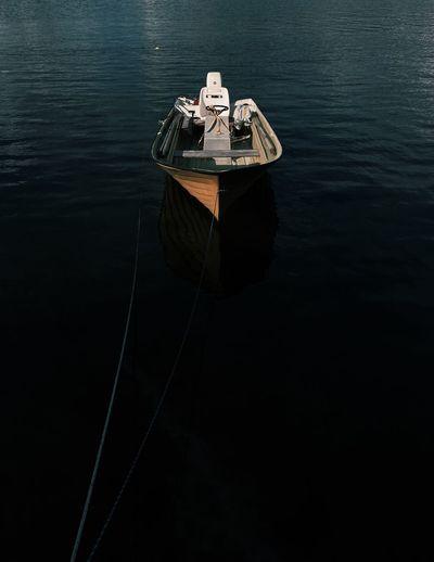 A single boat on dark water