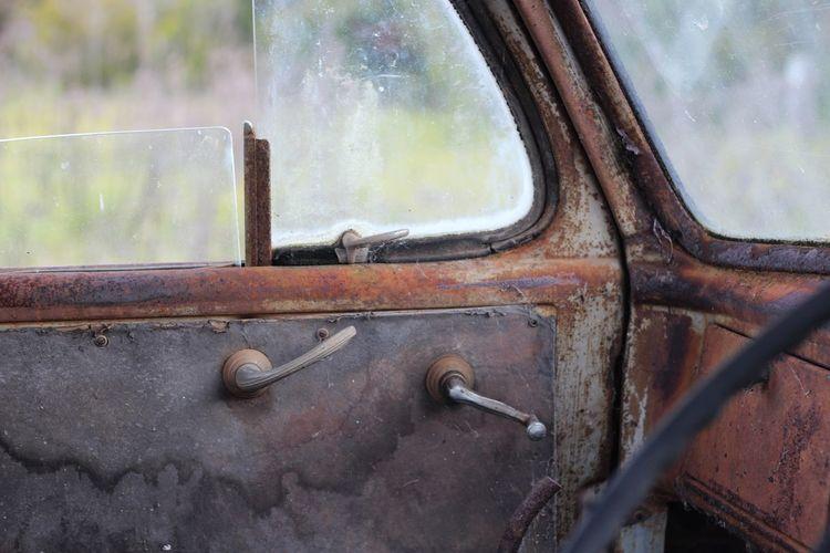 Close-up of rusty car window