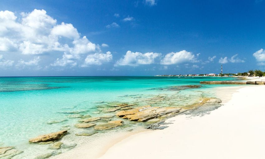 🌴i think its safe to say summer is upon us🌴~ Beach Sea Island Sand Tropical Climate Turquoise Colored Cloud - Sky Idyllic Blue Vacations Nature Sunny Water Tourist Resort Travel Destinations Landscape Turksandcaicos Grandturk Beauty In Nature