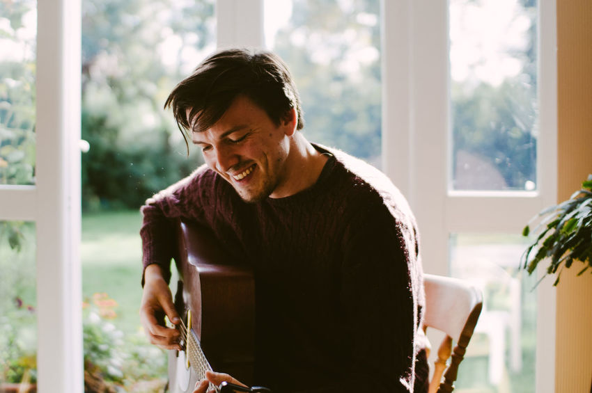 Backlight Day Guitar Guitarist Happiness Indoors  Looking Down Men Musician Natural Light Natural Light Portrait One Man Only One Person People Smiling Window
