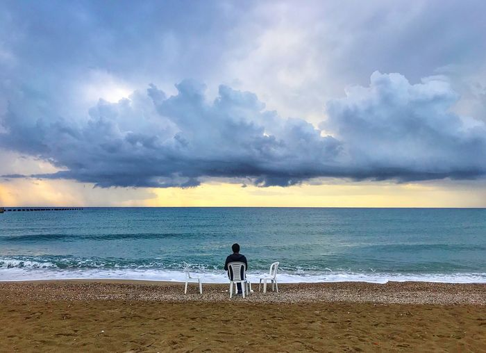 Sea and men Sea Beach Sky Land Water Cloud - Sky Horizon Over Water Beauty In Nature Horizon Scenics - Nature Sand Nature Real People Tranquil Scene Tranquility One Person Leisure Activity Full Length Standing Outdoors