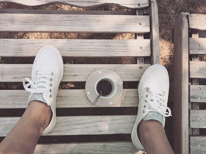 Human Leg Low Section Personal Perspective Shoe Directly Above One Person Human Foot Wood - Material Leisure Activity Real People Adult High Angle View Adults Only One Woman Only Coffee - Drink People Lifestyles Day Only Women