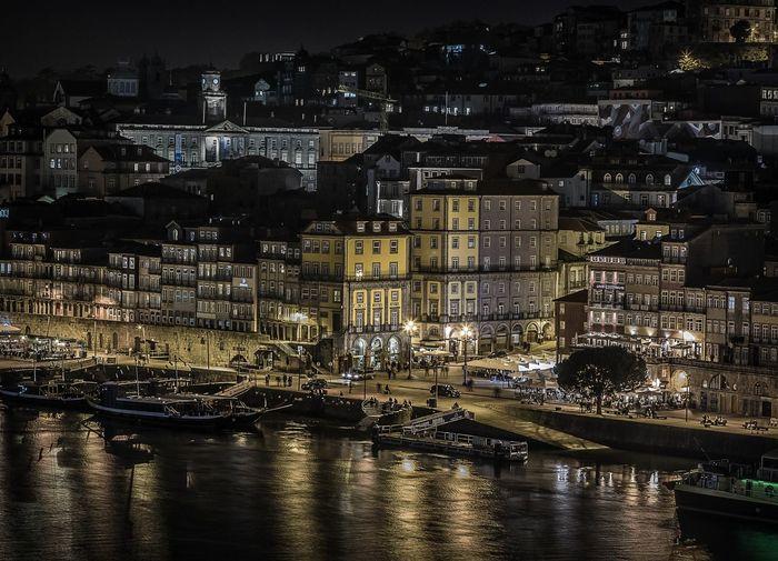 Sailboats in city at night