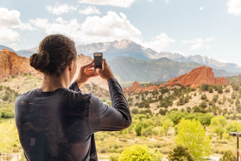 Mountain Scenics - Nature Photographing Photography Themes Technology Mountain Range Activity Landscape Adult Nature Beauty In Nature Environment Wireless Technology Real People One Person Sky Holding Leisure Activity