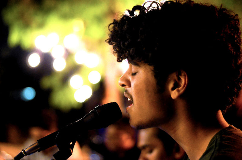Close-Up Of Young Man Singing At Concert