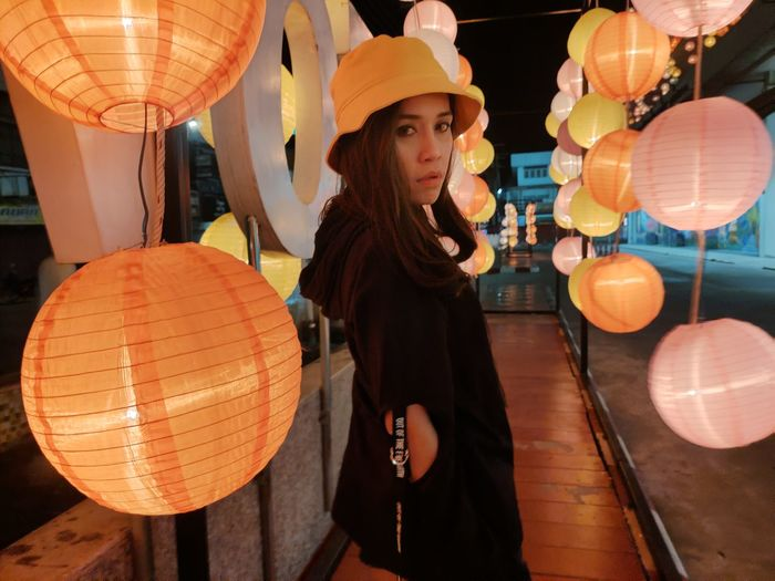 Woman looking at illuminated lantern