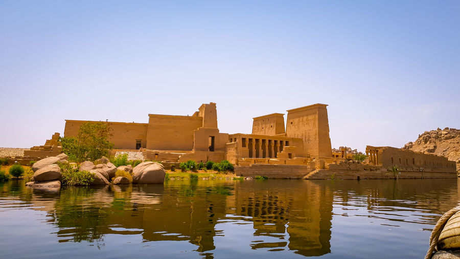 Reflection of temple in the nile in egypt