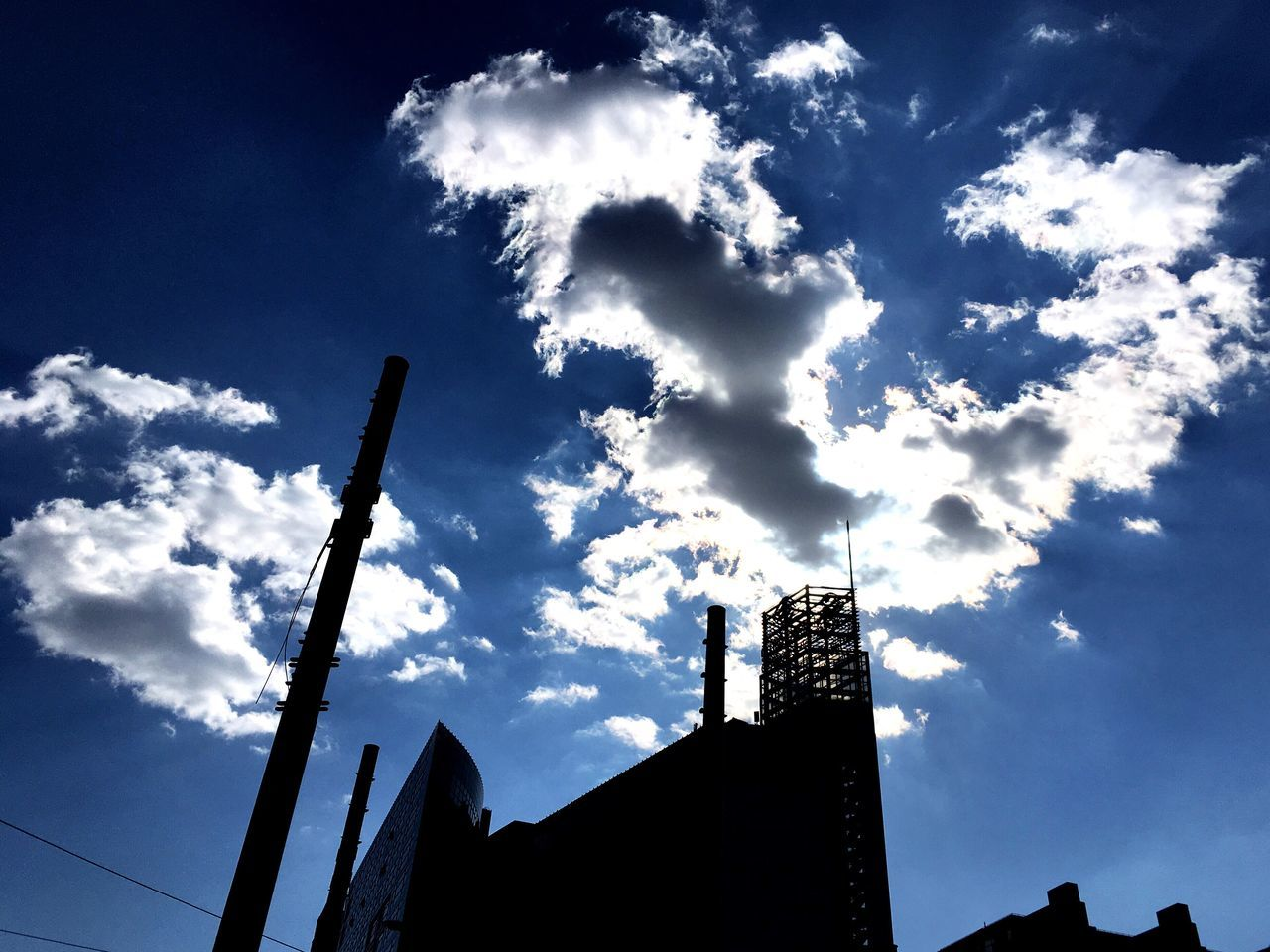 sky, built structure, architecture, low angle view, building exterior, cloud - sky, silhouette, no people, day, outdoors, smoke stack, skyscraper, nature