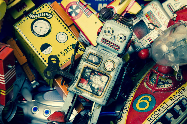 sad robot on a pile of old toys Old-fashioned Retro Unhappy Backgrounds Beat Up Close-up Creativity Full Frame High Angle View Large Group Of Objects Metal No People Old Toys Piled Up Robot Sadness Tin Toys Tired