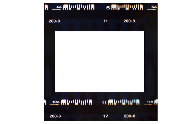 (35 mm.) film frame.With white space. Cut Out White Background Arts Culture And Entertainment Copy Space White Color Film Industry Black Color No People Camera Film Text Studio Shot Frame Blank Technology Western Script Indoors  Photography Themes Close-up Picture Frame Communication Film Strips Film Film Frames Vintage Photo Retro Striped Style Scan Design 35 Mm Camera Antique