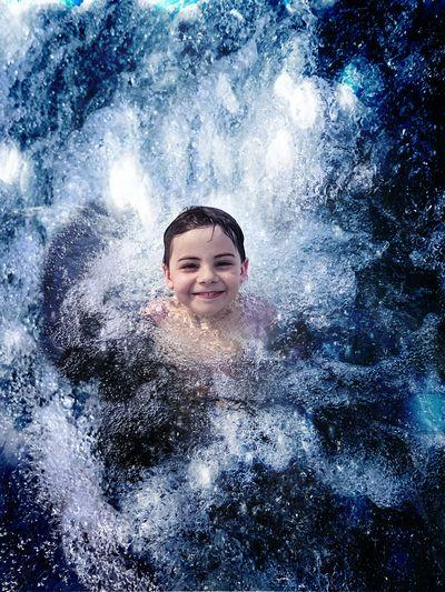 Portrait of boy in sea