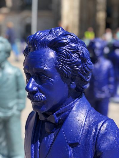 Close-up of statue against blue background