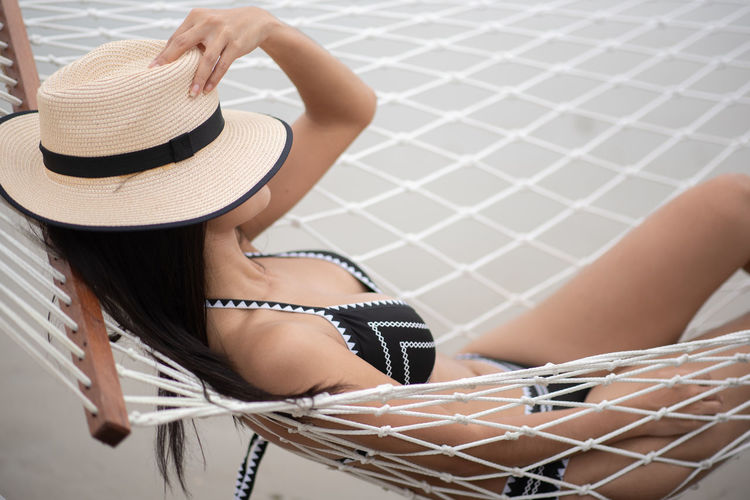 Clothing Hat One Person Young Women Women Sitting Adult Young Adult Leisure Activity Real People Lifestyles Sun Hat Indoors  Beauty Relaxation Beautiful Woman Rear View Hairstyle