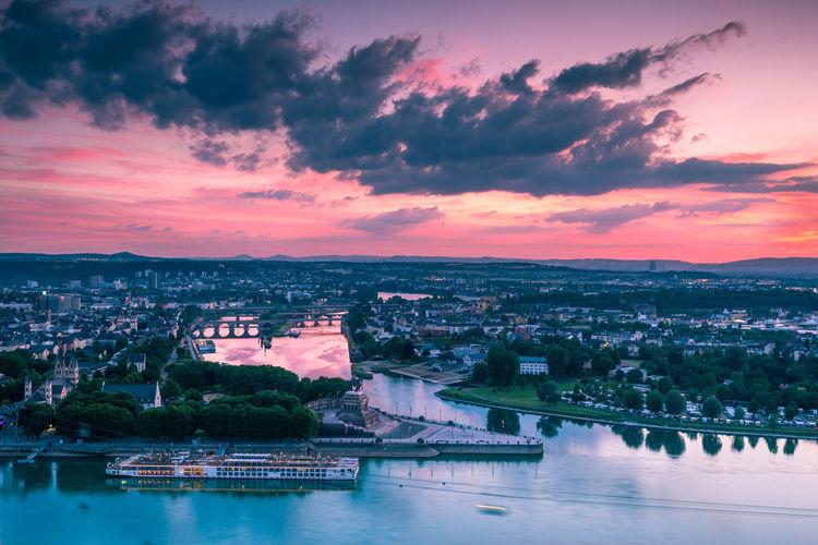 Aerial view of city against cloudy sky at sunset, deutsches eck, festung ehrenbreitstein