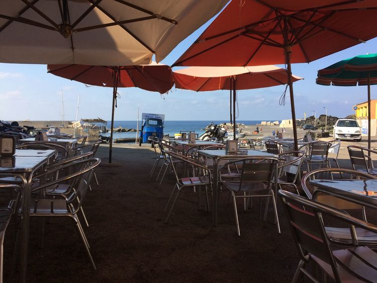 Linosa, Sicilia Linosa Mare ❤ Mediterranean  Porto Sicily Absence Bar Beach Cafe Canopy Chair Day Empty Group Of Objects Italy No People Nofilter Outdoor Cafe Outdoors Restaurant Sea Summer Sun Table