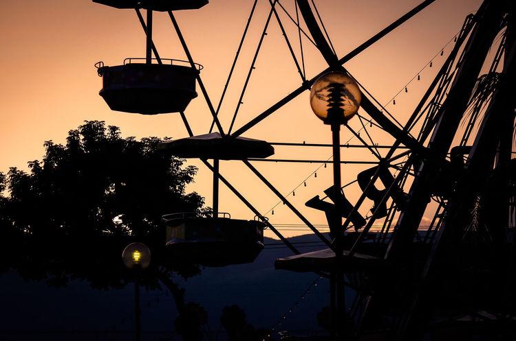 Nice sunset at the park... Amusement Park Ride Ferris Wheel Orange Color Outdoors Park Silhouette Sky Sunset