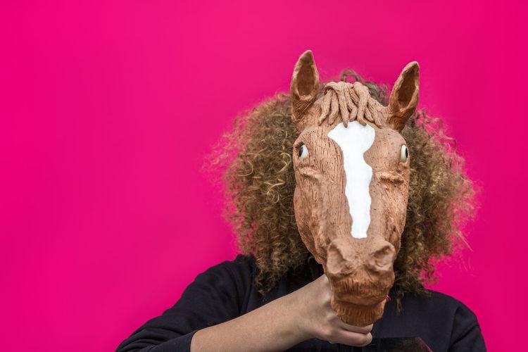 Close-up of teenage girl wearing animal mask