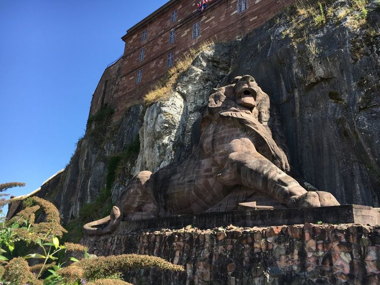 Lion Belfort France Statue Sculpture Human Representation Low Angle View Old Ruin History Travel Destinations The Past Day Famous Place Tourism Weathered Creativity Ancient Ancient History Rock Formation Memories No People Geology Stone Material