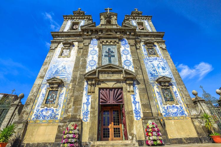 Azulejo tiles covering the facade of Saint Anthony's Church Congregados in Almeida Garrett square, Porto historic center, Portugal, Europe. Portugal Porto Tourism City Aerial View Cloudscape Cityscape Landscape Panorama Europe People Church Church Architecture Architecture Town Porto Portugal 🇵🇹 Monment Oporto City Oporto Downtown Oporto Streets Low Angle View Built Structure Building Exterior Building Sky Religion Place Of Worship Belief Spirituality Blue Day History Nature The Past Window No People Outdoors Architectural Column Ornate