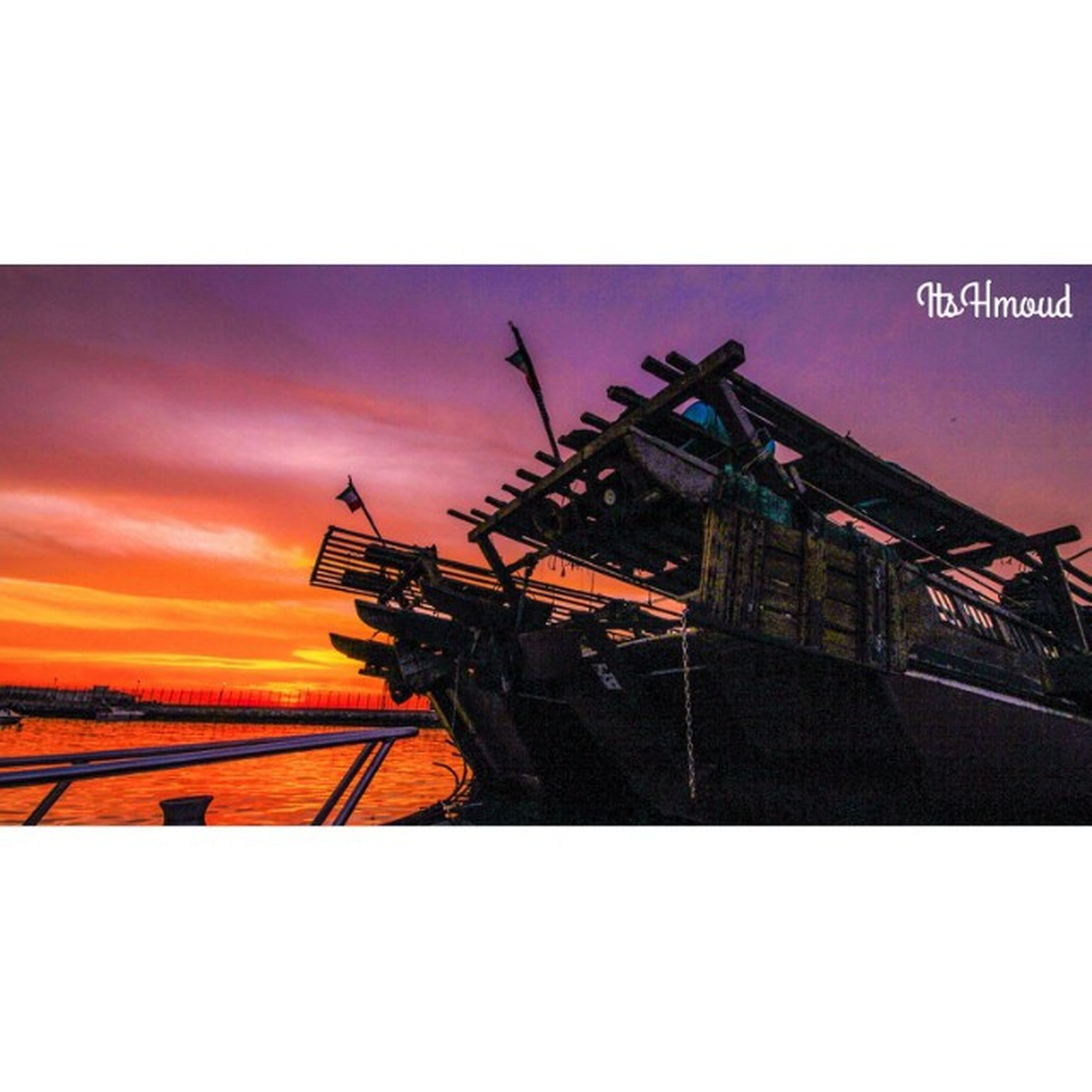 transfer print, sunset, auto post production filter, orange color, sky, copy space, built structure, low angle view, architecture, outdoors, no people, construction site, crane - construction machinery, building exterior, industry, silhouette, transportation, metal, clear sky, nature