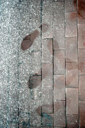 Snowprints Cobblestone Dusting Flooring Footpath FootPrint Footprints Low Section Pattern Pavement Paving Stone Shadow Sidewalk Snow Speckled Street Tile Tiled Floor Walking Winter