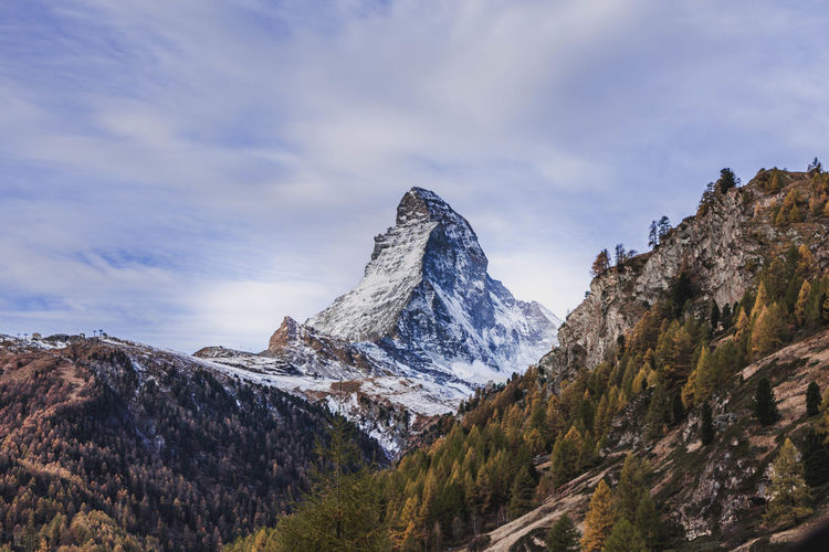 The Matterhorn. Mountain Sky Beauty In Nature Scenics - Nature Cloud - Sky Tranquil Scene Winter Tranquility Snow Cold Temperature Mountain Range Nature Environment Non-urban Scene Landscape No People Idyllic Day Tree Mountain Peak Snowcapped Mountain Outdoors Formation
