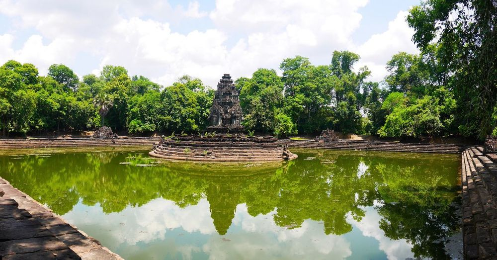 Tree Cloud - Sky Reflection Water Sky Statue No People Nature Outdoors Spirituality Day Sculpture Architecture Beauty In Nature in Neak Pean Cambodia BYOPaper!
